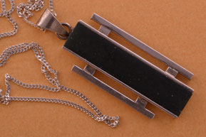 Silver Retro Pendant With A Black Stone
