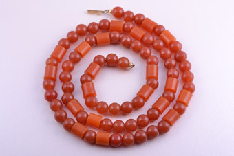 Plastic Vintage Necklace With Amber-Coloured Beads