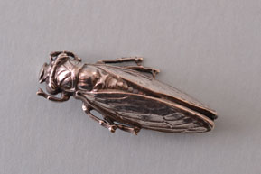 Silver Victorian Cicada Bug Brooch With A Pattern On Its Wings