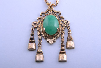 1960's Gilt Pendant With Tassels And Green Stone