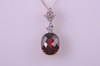 9ct White Gold Modern Pendant With Garnet And Diamonds