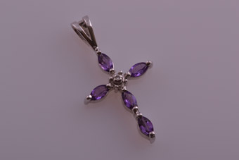 9ct Gold Modern Cross With Amethysts And A Diamond