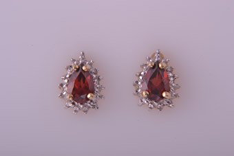 Yellow And White Gold Stud Earrings With Garnets And Diamonds