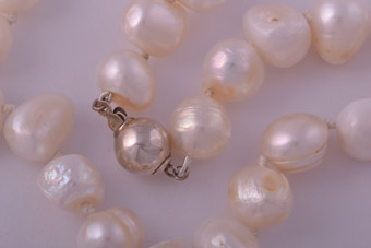 Modern Pearl Necklace With A Silver Clasp