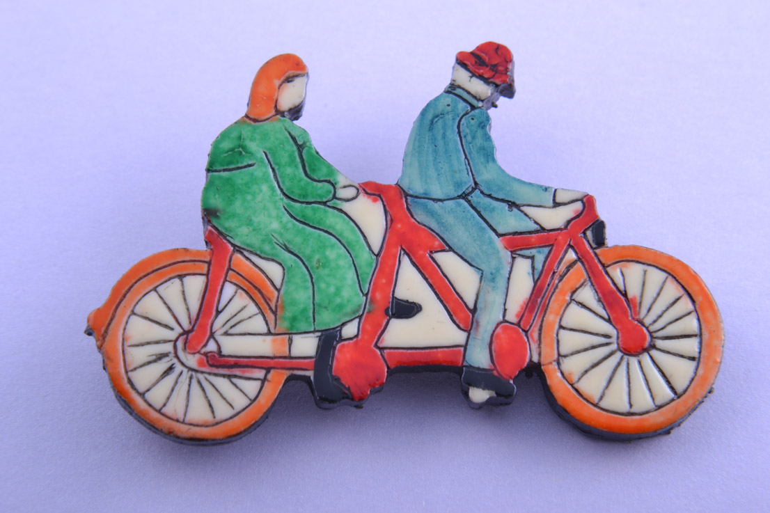 Plastic Tandem Brooch With Cyclists