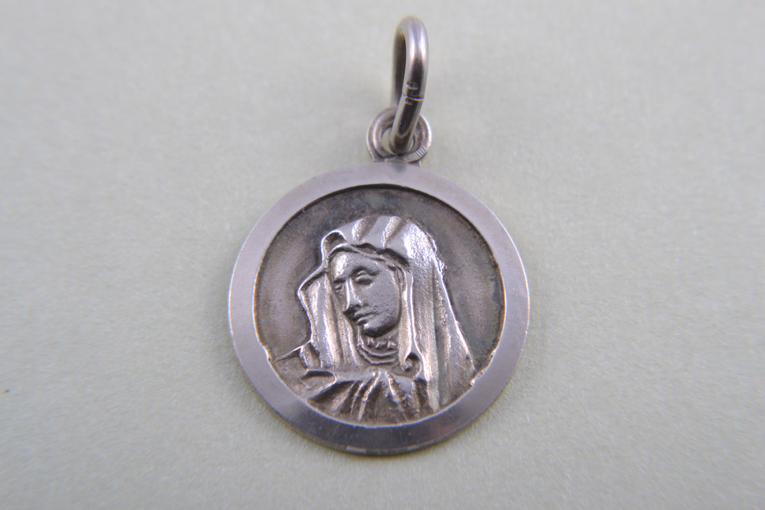 Silver Charm With Religious Figure