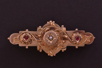 Gold Edwardian Etruscan Style Brooch With Rubies And A Pearl