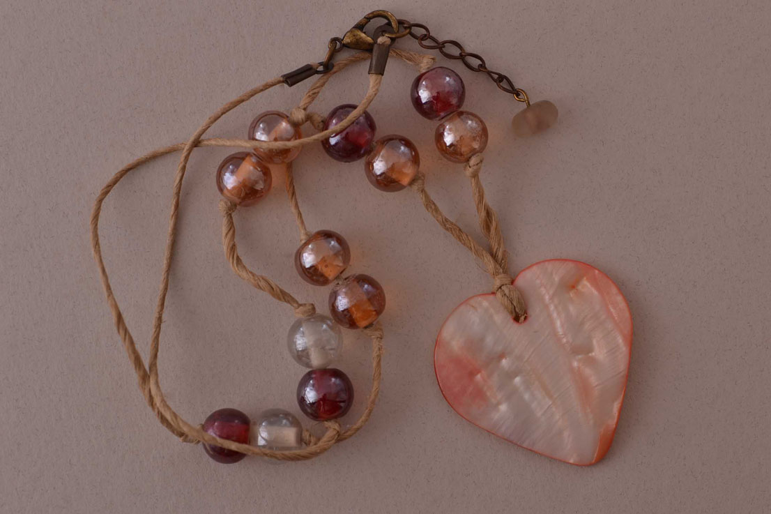 Modern Necklace With A Shell Heart Pendant And Glass Beads