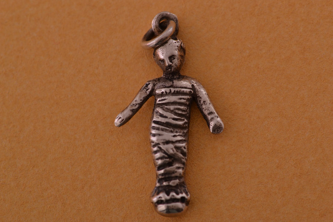 Silver Vintage Charm With Arms Astride And Wrapped In Fabric