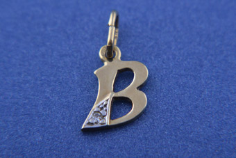 14ct Yellow Gold Charm With A Diamond