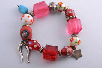 Modern Bracelet With Beads And Charms