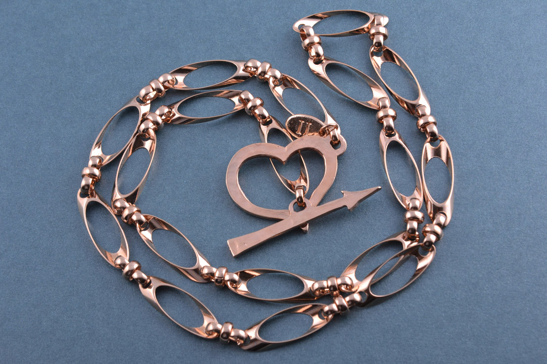Gilt Modern Chain Necklace With Heart And Arrow Closure