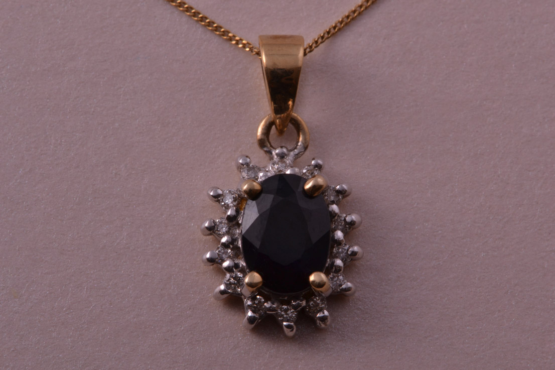 9ct Gold Modern Pendant With A Sapphire And Diamonds