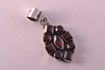 Silver Modern Pendant With Garnets